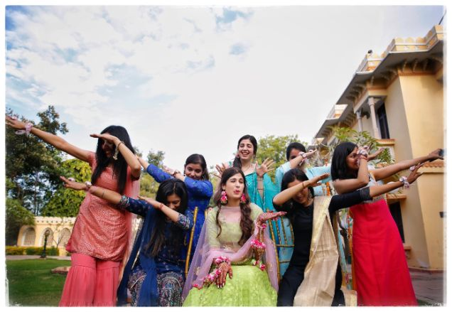 indian bride posing with bridesmaids  Wedding in  Orchha with a Reception Lehenga to Drool Over