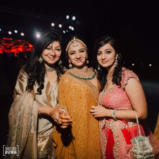 indian bride posing with bridesmaids   Destination wedding in Fujairah