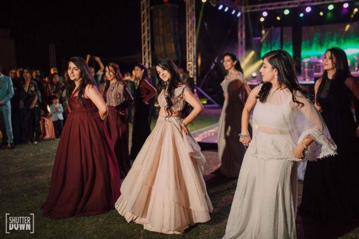 indian bride dancing with bridesmaids
