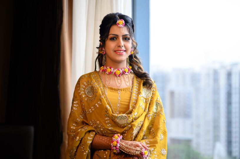 yellow outfit for haldi day | floral jewelry for the bride |
