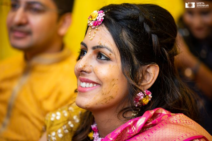 beautiful bride adorned with haldi | floral jewellery ideas for the bride |