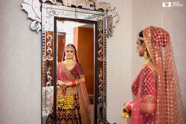bridal shoot poses | bridal outfit ideas | Sabyasachi Lehenga in Maroon