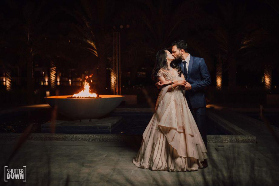 kissing couple   indian wedding