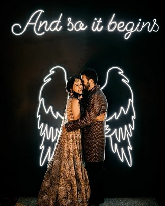 Neon wedding signs | angle wings | Budget wedding décor ideas