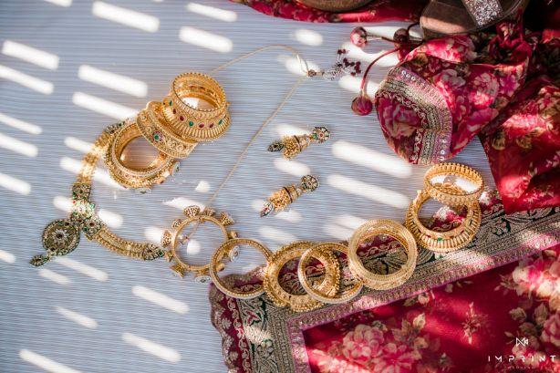 bridal detail , indian wedding , destination wedding in india , red lehenga , bridal details ,  Sabyasachi lehenga | wedding in Abu Dhabi|