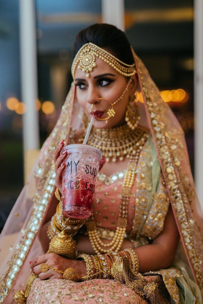 bride sipping an iced drink