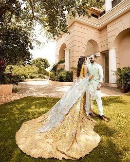 yellow lehenga with a thigh high slit and a trail