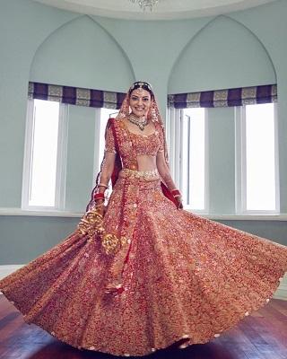 Twirling bride in Anamika Khanna bridal lehenga