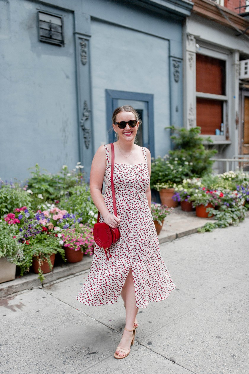 Meghan Donovan of wit & whimsy wears the Reformation Persimmon Dress