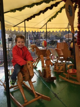 E was so excited to ride these carved carousel animals!
