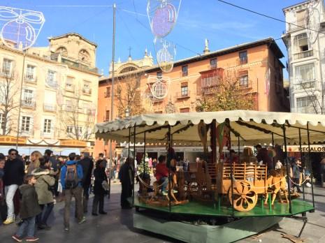 Sunny, busy plaza in downtown Granada