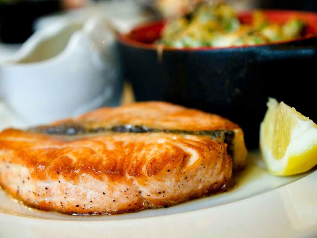 Salmon, a kind of fatty fish that reduce blood cholesterol