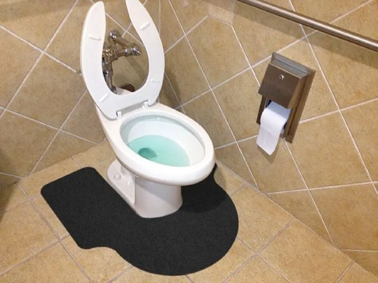 Black WizKid Products Big A Antimicrobial Mat Installed In Public Restroom