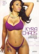 Kyra-Chaos-showing-off-her-cleavage-and-sexy-curves-in-purple-lingerie-in-her-shoot-with-BlackMen-Magazine