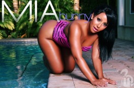 Mia-Bunny-poolside-on-all-fours-showing-off-her-sexy-curves-in-a-pink-and-black-swimsuit-in-her-shoot-for-MJ-Flix