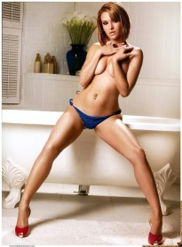 Sally-Ferreira-sitting-on-the-bathtub-topless-modeling-blue-bikini-bottoms-and-red-heels-for-Smooth-Girl-Magazine
