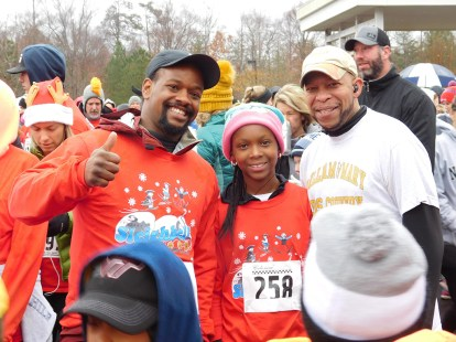 Participants of the Sleighbell 5K give a thumbs up with Jamestown principal, Howard Townsend.