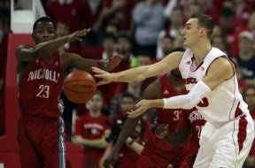 Wisconsin forward Sam Dekker (15) passes as Nicholls State guard Quinton Thomas (23) defends. PHOTO: Mary Langenfeld, USA TODAY