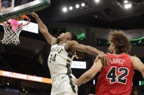 Bucks Giannis dunks over Bulls Lopez AP