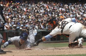 Brewers Grandal slides Giants Posey AP
