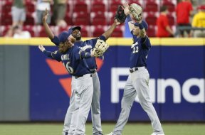Brewers Gamel Cain Yelich celebrate AP