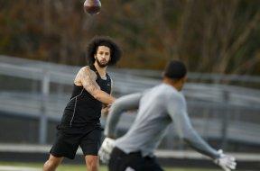 Colin Kaepernick throwing AP