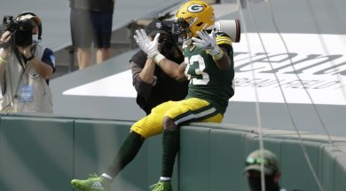 Aaron Jones fanless Lambeau Leap AP