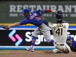 Brewers Cubs Bradley slide AP