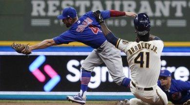 Brewers Cubs Bradley slide AP
