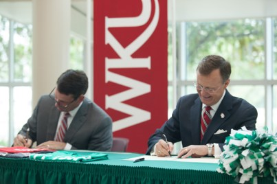 WKU President Gary Ransdell and Ivy Tech Community College Chancellor Jonathan Weinzapfel signed a joint admissions agreement Aug. 5 in Evansville, Ind. (WKU photos by Clinton Lewis)