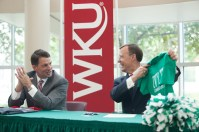 Jonathan Weinzapfel (left) and WKU President Gary Ransdell exchanged gifts during the ceremony Aug. 5 in Evansville, Ind.