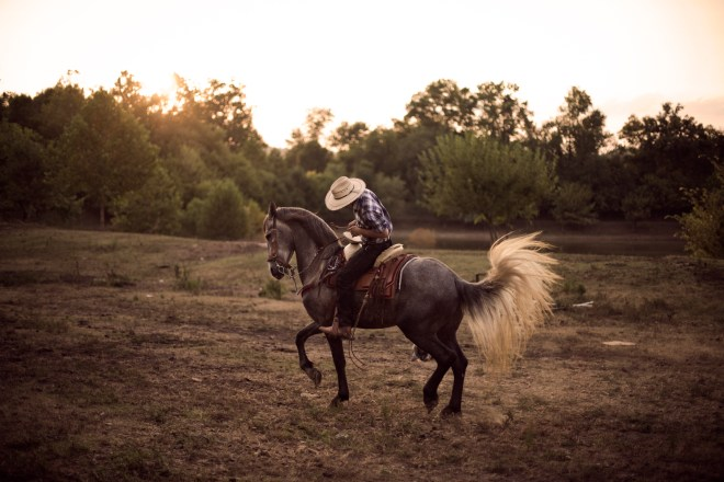 Marcos Espinosa, 17, from Mexico and Guatamala is takes his horse, Maximilliano, for a ride on his uncles ranch in Bowling Green Kentucky. Espinosa represents a group of young hispanics who are split between the American and Hispanic culture.