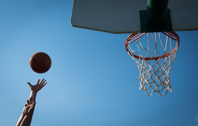 """Players compete for a jump ball at a pickup basketball game at Roland Bland Park in Bowling Green, Ky. on March 26, 2016. """"It's my way to get exercise,"""" said Anthony Hart (21). """"I love watching it on TV, playing it myself. I have always loved the sport."""""""