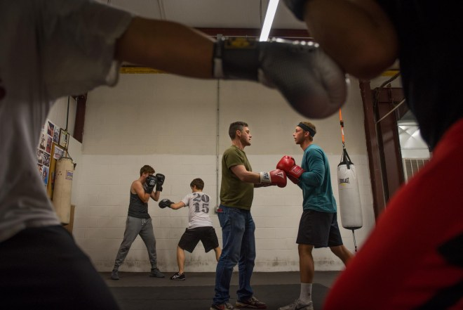 Chadrick Wigle teaches students at his newly-opened BGKY Boxing Club in Bowling Green, Ky. on April 6, 2016. His experience as a coach at the NCAA Division I level has brought him dozens of new clients who were waiting for a boxing gym to open close to home. Whether or not it is school-sanctioned, Wigle will be leading a Western Kentucky University boxing team in the coming years. Gabriel Scarlett