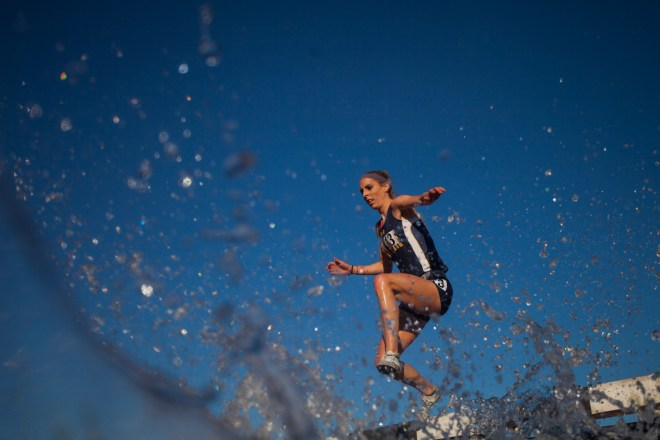 Kent State's Caroline Sauers jumps an obstacle in the 3000-meter steeple chase during the Hilltopper Relay April 9, 2016 at Charles M. Rueter Track and Field Complex in Bowling Green, Ky. Sauers finished 5th overall with the time of 11minutes 3 seconds.