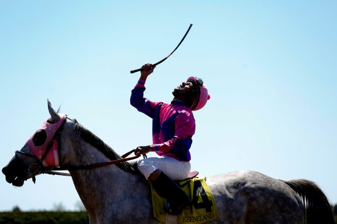 Shaun Bridgmohan celebrates his 1st place victory riding four-year-old Miss Pink Diva during the Maiden Special Weight horse race at Keeneland Racecourse on April 17, 2016. The win was a first for Miss Pink Diva, earning $36,000.