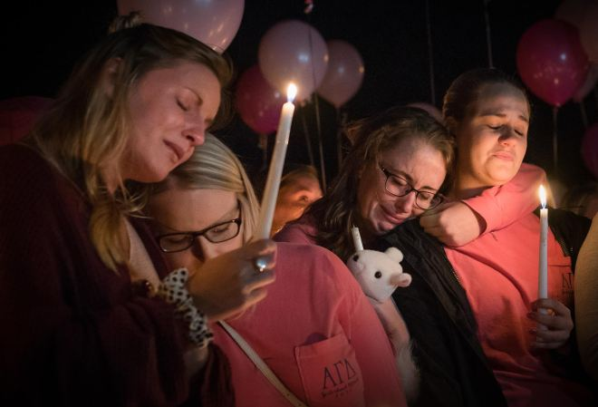 """From left to right, Hayley Hoback, Izzy Rager, Morgan Goetz and Rachel Shipp lean on one another at a vigil to memorialize their Alpha Gamma Delta sister, Stephanie Campbell, on Wednesday, Sept. 28 at the AGD sorority house. Campbell passed away Sunday, Sept. 25 as a result of a single-car accident on the Western Kentucky Parkway. """"She has tattooed on her foot 'You can breathe,'"""" remembered Hayley Hoback at the vigil. """"And that's what I can say to her. 'You can breathe now.' She's in a better place now.Ó 