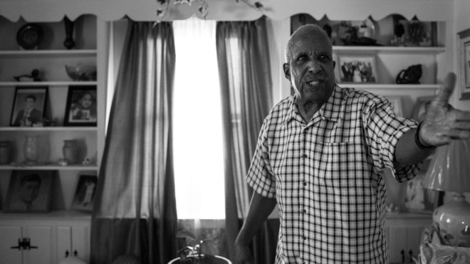 "Arthur Woodsen, 74, becomes aggravated on the topic of civil rights in the living room of his home in Bardstown, KY. Woodsen grew up in the midst of the Civil Rights Movement in the 1950s and 1960s. ""My race of people were looked at as not even being human,"" said Woodsen. ""And that same segregation is still around today. God's blessed me to live seventy four years, and I've seen this country get worse instead of better."""