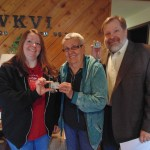 Nancy Dembowski (middle) presented Anita Goodan (left) and Jerry Curtis (right) with a pedometer to kick off the campaign.