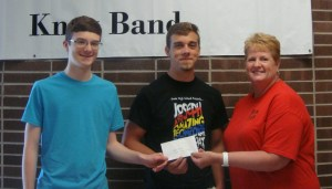 Knox Band Drum Majors Colin Kupla (left) and Cody Himes (center) were notified by Tri Kappa member and High School Principal, Dr. Elizabeth Ratliff, that their trip to Drum Major Camp in July is being supported by a $1,000 check from the Knox Tri Kappa Chapter, a philanthropic organization focusing on charity, culture, and education.