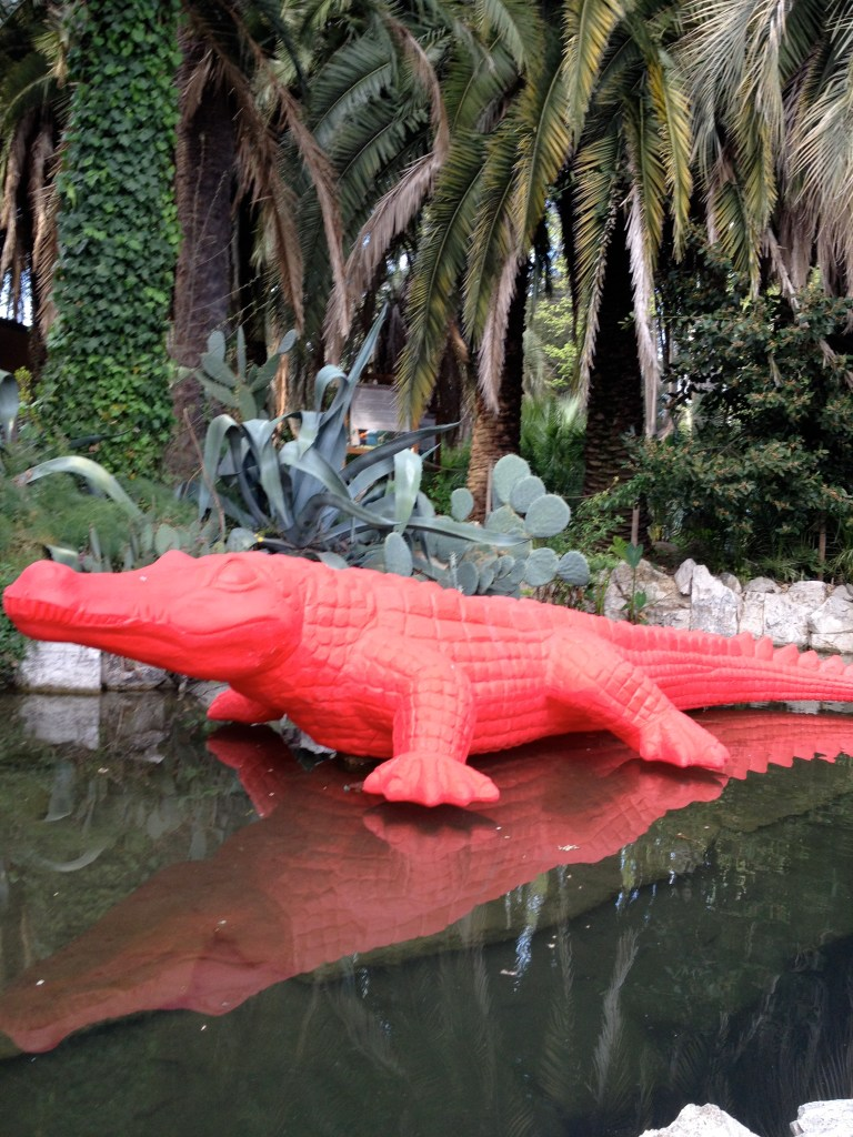 Reflections of a Borghese Crocodile (Red sculpture of a crocodile in the Villa Borghese Gardens)
