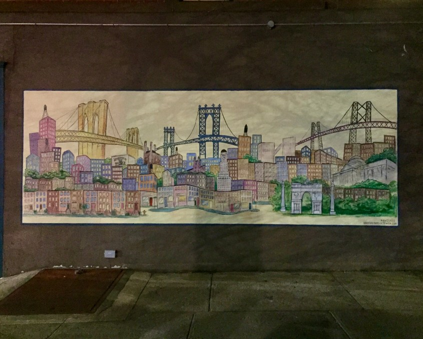 A mural of the Brookyn, Manhattan and Williamsburg bridges as seen over Brooklyn's skyline