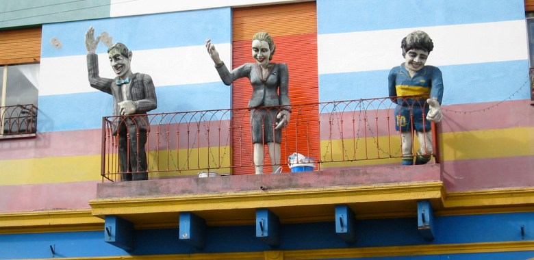 close up of Carlos Gardel, Evita, Maradona on a Balcony in Caballito, with Rodan proportions—giant hands