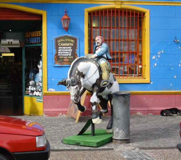 Statue of The Caballero of Caballito riding hard out into the street