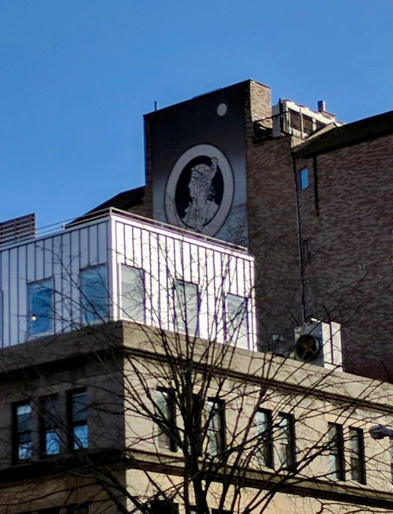 5th Story Mural of an Aloof Victorian Silhouette with Moon above