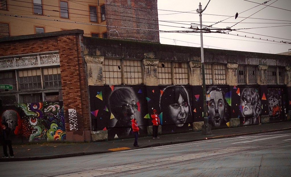 Wide shot of the Good People of Seattle, a wrap around mural of faces