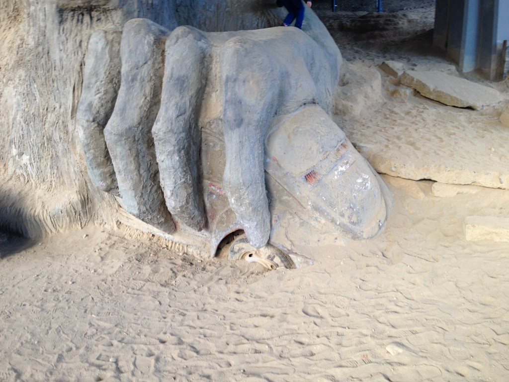 Close up of the Fremont Troll crushing a VW bug.