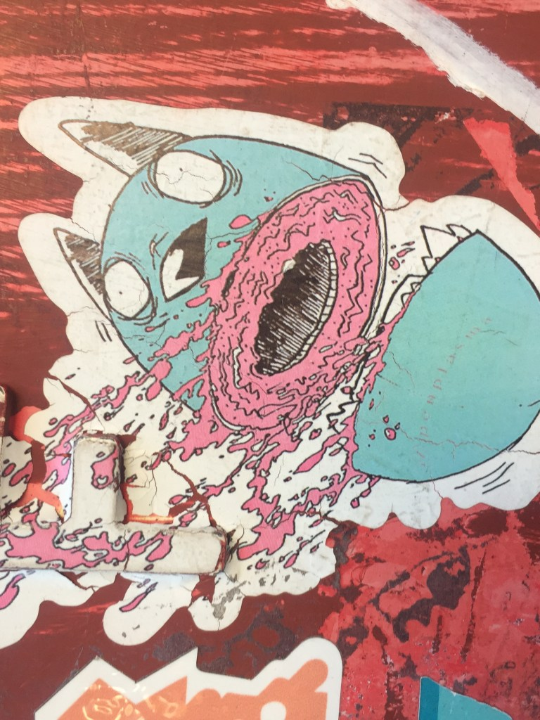 Sticker of a Sliced Blue Egg Creature, falling to the right, a trail of pink blood in its wake.