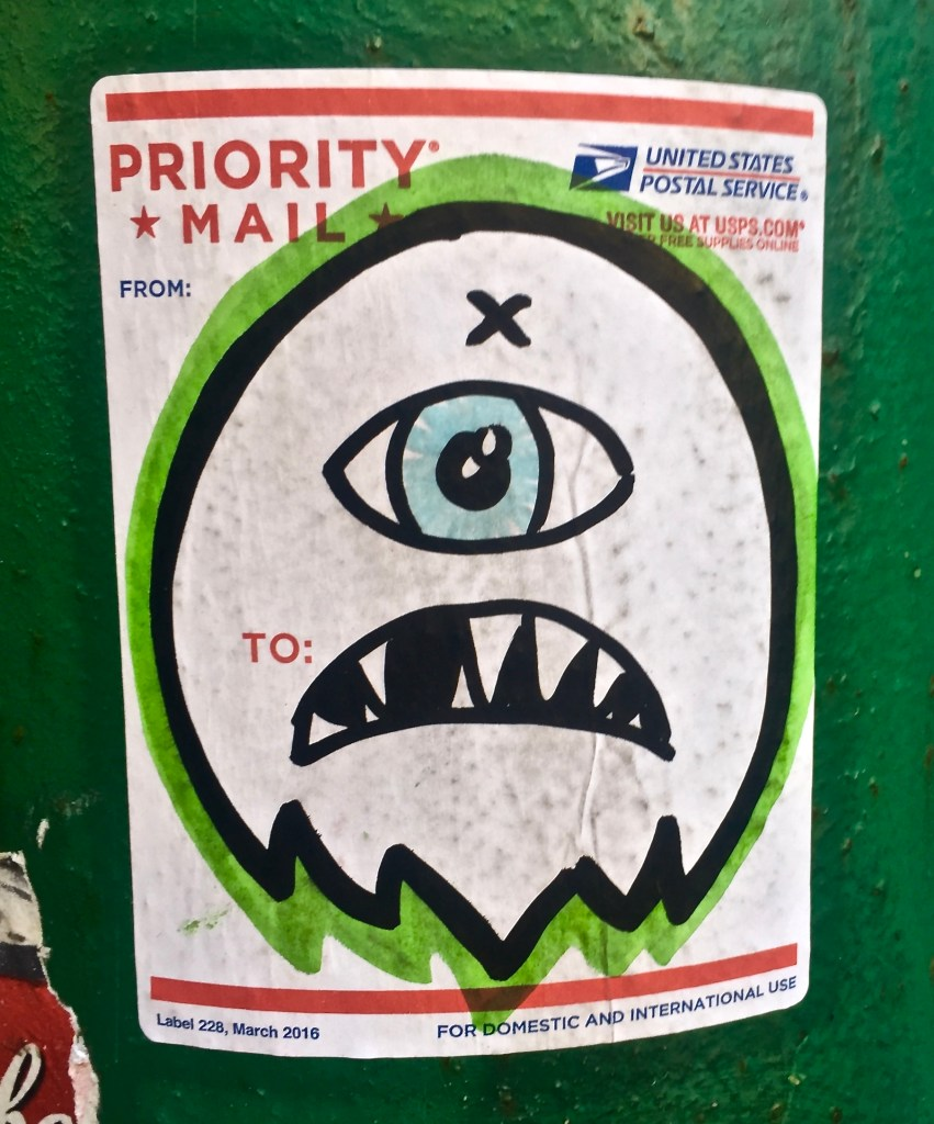 One-eyed monster inked on a Priority Mail label