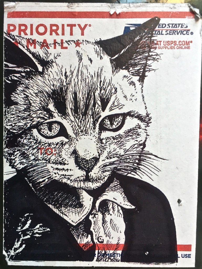 Using free stickers for art: Cat in a suit on a Priority Mail Label